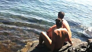 Nudist female with big clit uncovered on beach voyeur cam