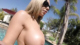 Olivia Austin has some summer divertissement in the pool