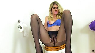 English milf Elegant Eve gets naughty in bathroom