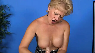 Breasty Mature Blonde Consequential a Handjob